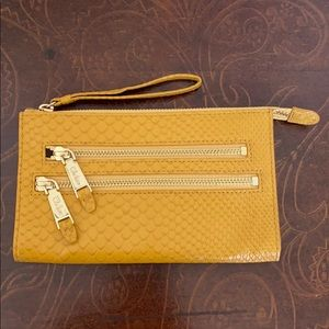 Cole Haan small gold/yellow wristlet